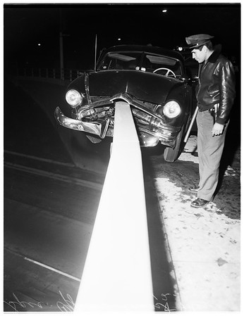 Car out of control ...almost went over overpass at Atlantic Avenue over the Santa Ana Freeway ...occupants unidentified, 1951