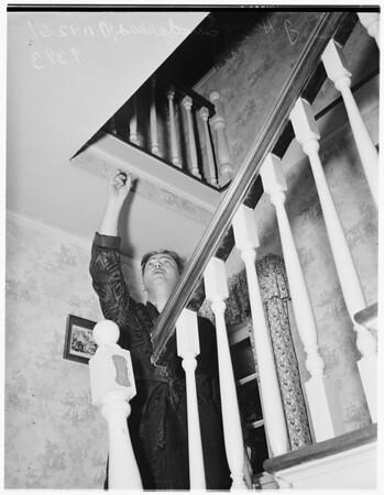 Wife beaten by burglar at 2800 North Beachwood Drive, 1951
