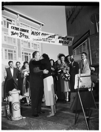 """Optimist Week Celebration""... Optimistic Man Kissed by Miss Santa Monica Bay Optimist and City College student, 1951"