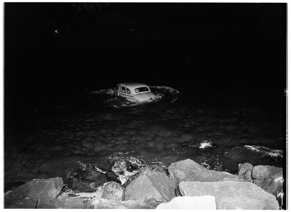 Auto into Ballona Creek... view of car in creek, 1951