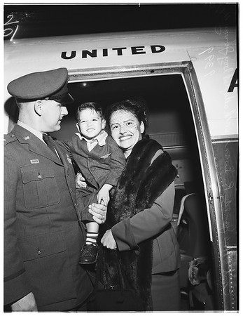 Korean boy adopted...arriving at International Airport, 1951