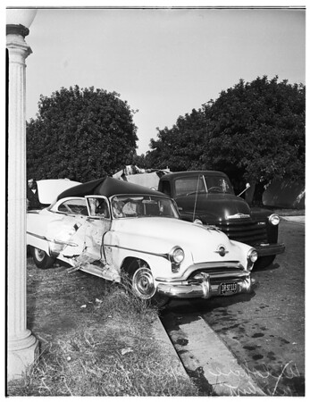 Traffic accident... Wilshire Boulevard and Muirfield Road, Los Angeles... wife thrown from car, 1951