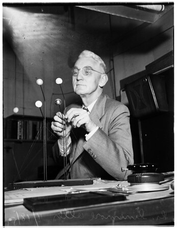 Doctor Dinsmore Alter (With Model of Device Used to Show Diameter of Pluto), 1951