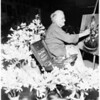 "Seventy-nine-year old artist doing ""Flower Portraints"" at Flower Show, 1951"