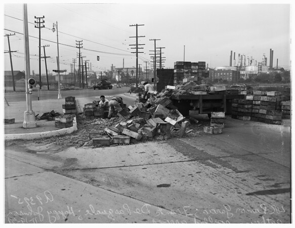 Truck overturns and spills load of grapes at Figueroa Street and B Street, Wilmington, 1951