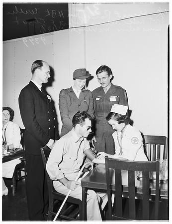Korea war veterans on United Nations tour...at Red Cross Center, 1951