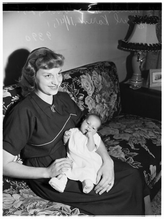 Navy man's wife and baby, born ten days after father went to sea, 1951