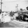 Truck loaded with cotton overturns... 525 San Fernando Road, 1951