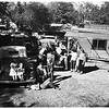 Old cars rebuilt in back yard as a hobby ...Eleven of fourteen Henkel children work on old autos, 1951