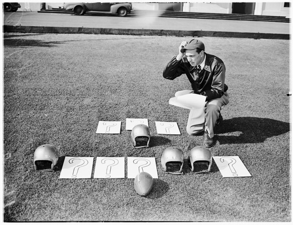 Loyola coaches checking players and plays, 1951