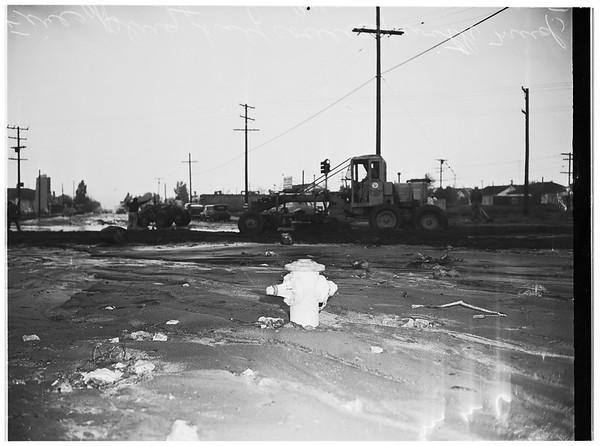 Rain damage ...Mud-Covered fire plug ...Road scrapers cleaning road at Glen Oaks Boulevard and Hollywood Way, 1951