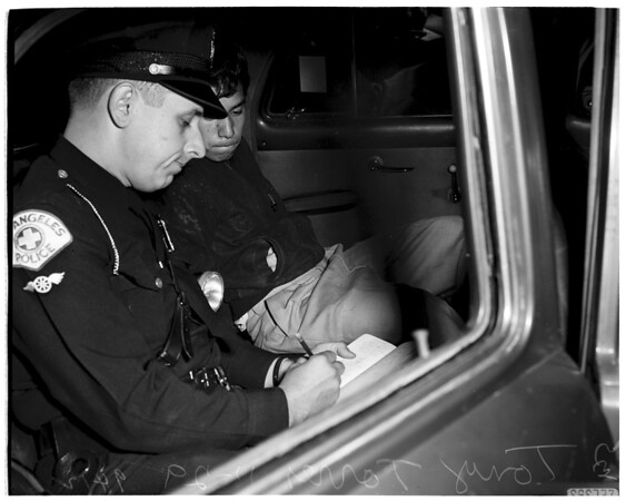 Burglary suspects caught...escape car crashes into house, 1951