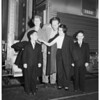 War orphans on trip to the United States, being greeted by sponsors, 1951