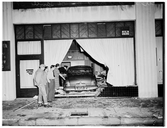 Auto drives into store front... 1004-1006 Santee Street, 1951
