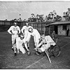 Football ...University of California, Los Angeles Coach on Wheelchair on Field, with team, 1951
