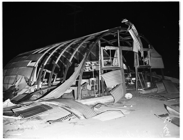 Explosion at motorcycle club's quonset hut... overall shot where blast was set off, 1951