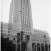 New halyard on City Hall flag pole... pan shot, 1951