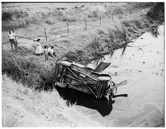 Accident... car in slough at 198th Street and Main Street, 1951