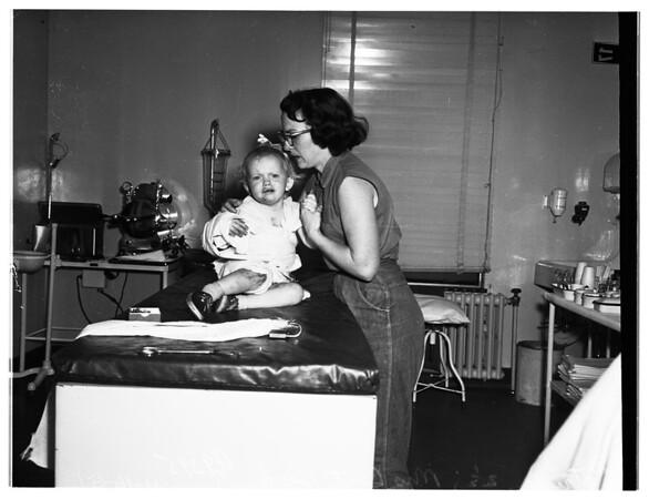 Child severely burned, 1951