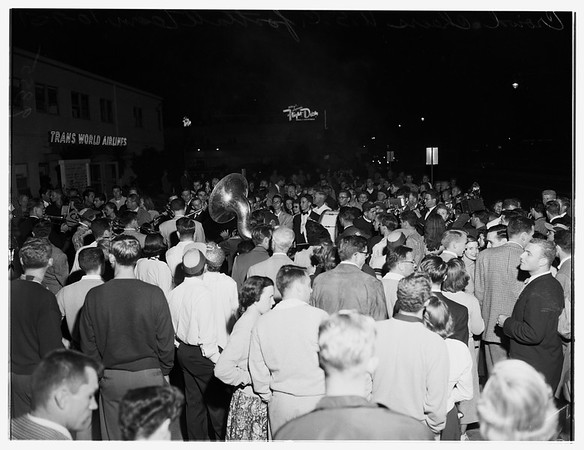 University of Southern California football team arrives (Airport), 1951