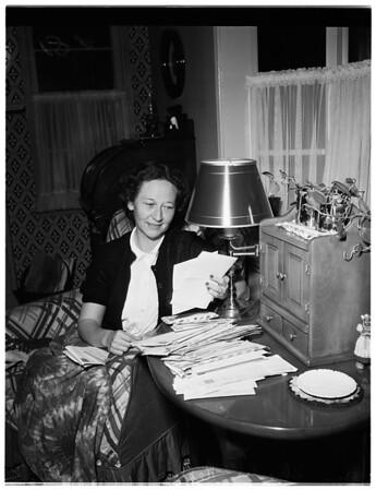 """Soldier's mother reading """"Dearest Mom"""" letters she received from Korea, 1951"""