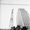 New halyard on City Hall flag pole... pan shot, 1951