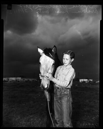 Polio victim rides again, 1952