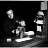 Dog belonging to narcotics suspect at West Los Angeles desk for safekeeping, 1952