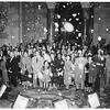 Christmas carols at City ...Los Angeles concert youth chorus ...Snow falls as they sing in rotunda, 1951