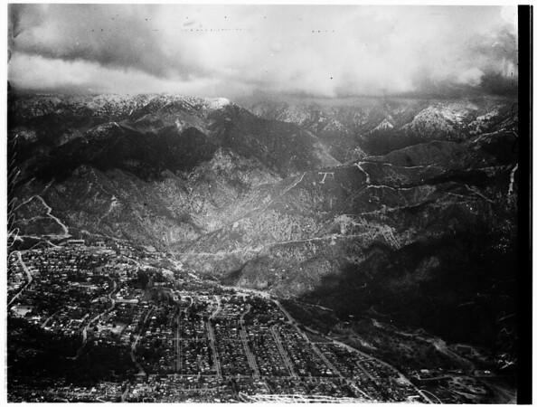 Snow on mountains seen from Los Angeles, 1952