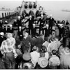 Christmas ...Los Angeles Cruiser Party ...Picture of Groups Singing Carols, and Seamen Teaching Children to Aim Anti-Aircraft Guns, 1951