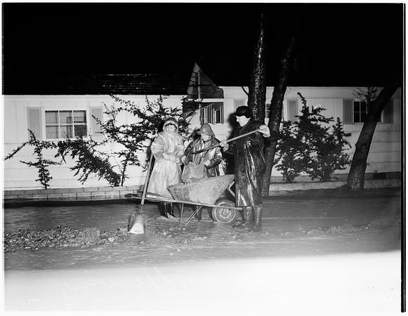 Sand-bagging against storm ...884 North Beverly Glen Boulevard, 1952