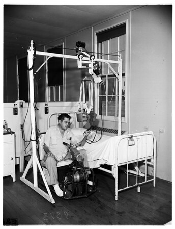 Polio invalid and his electric hoist...Veterans Administration Hospital, Long Beach, 1951