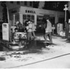 Victim of heart attack sets gas pumps afire in gas station ...at Wilshire Boulevard and 9th Street, Santa Monica, 1952.
