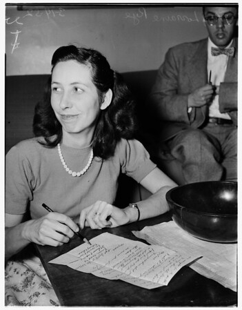 Wife receives letter from soldier husband, 1952
