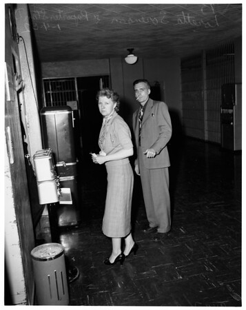 Wife shoots husband in quarrel, 1952