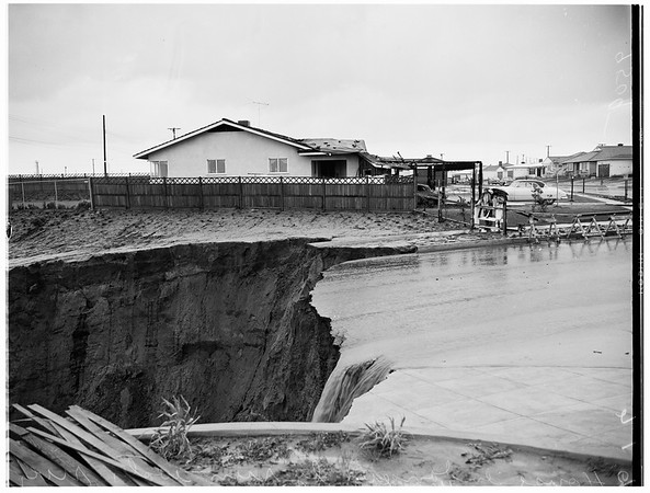 House endangered by rain water river, 1952