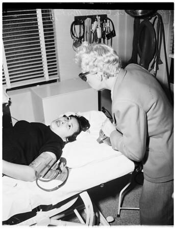 Snake woman bitten, 1952
