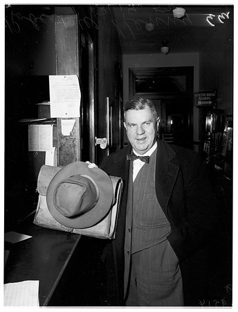 Robert W. Kenny booked on drunk driving charges, 1952