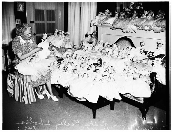 Christmas dolls...she dresses them yearly for poor children in all nations center, 1951