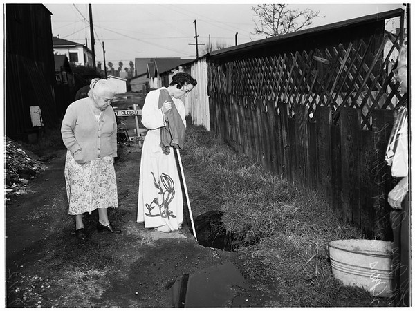 Hole in alley, 1952