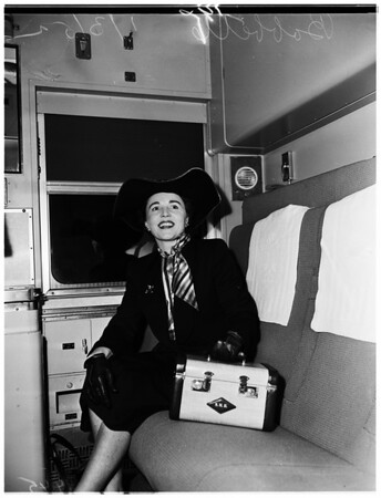 Babette leaving for New York to cover spring fashion show, 1952