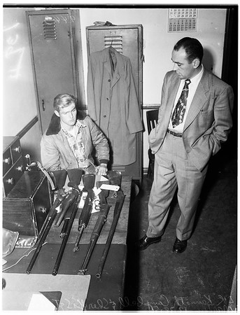 Phantom gunman suspect ...in Firestone Park Sheriff's Sub-station ...with collection of guns found in his car, 1951