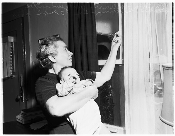 Windows shot out by vandals, 1952