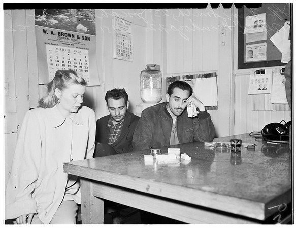 Narcotisc suspects ... Central station... $4,000 to $5,000 worth of heroin in front of them, 1952