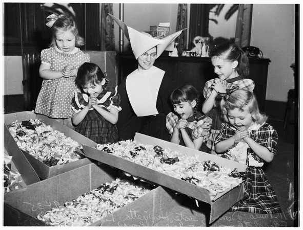 Christmas ...Los Angeles Orphanage kids get new hair ribbons, 1951