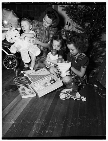 Inglewood family burned out of home gets Christmas from church and other groups, and Elks, 1951