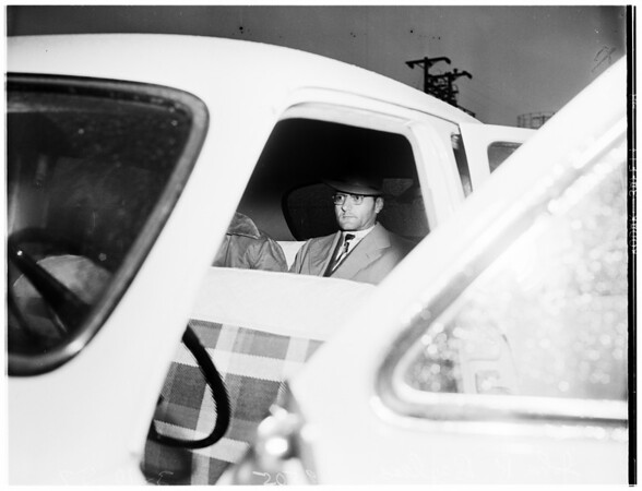Bank robber on way to jail, 1952