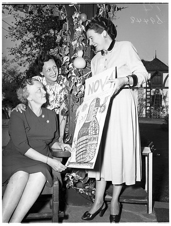 Cathedral Chapel Mothers' Club members planning party ...with poster, 1951