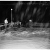 New rain and flood danger hit valley ...Reseda Area ...radio car on patrol at Sherman Way and Winnetka Avenune, 1952